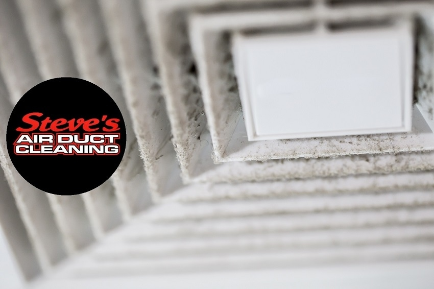 Close-up of dusty air vent with Steve's Air Duct Cleaning logo